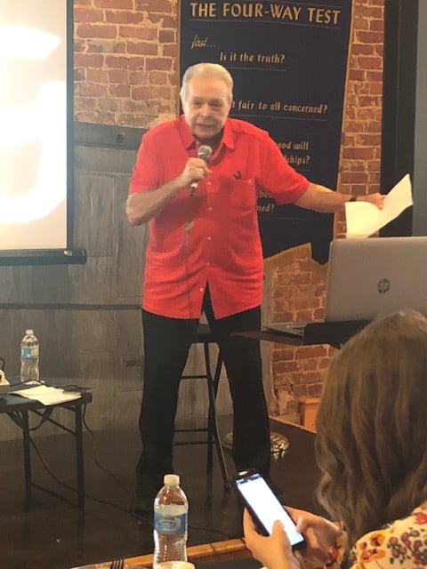 Mickey Gilley speaks with Rotary club